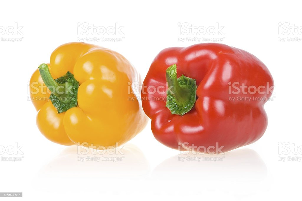 Ripe Yellow and Red Paprika Isolated royalty-free stock photo