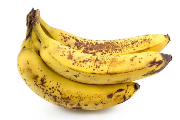 ripe yellow bananas fruits, bunch of ripe bananas with dark spots on a white background with clipping path. - ripe stock photos and pictures