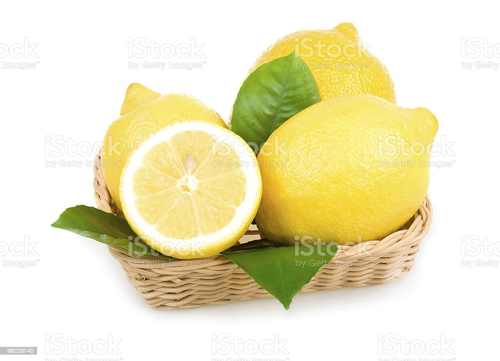 Ripe Yellow Lemons Isolated in Basket royalty-free stock photo