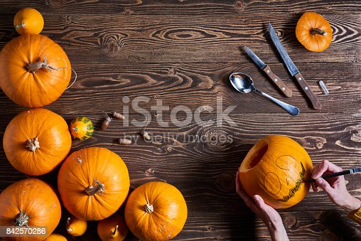 istock Ripe yellow pumpkins over wooden background 842570286