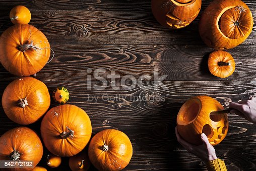 istock Ripe yellow pumpkins over wooden background 842772192