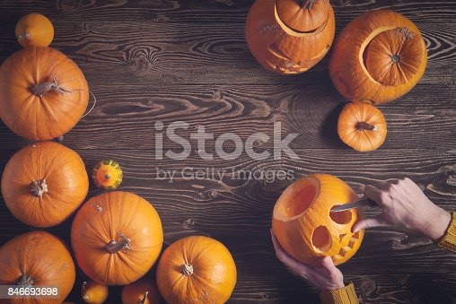istock Ripe yellow pumpkins over wooden background 846693698