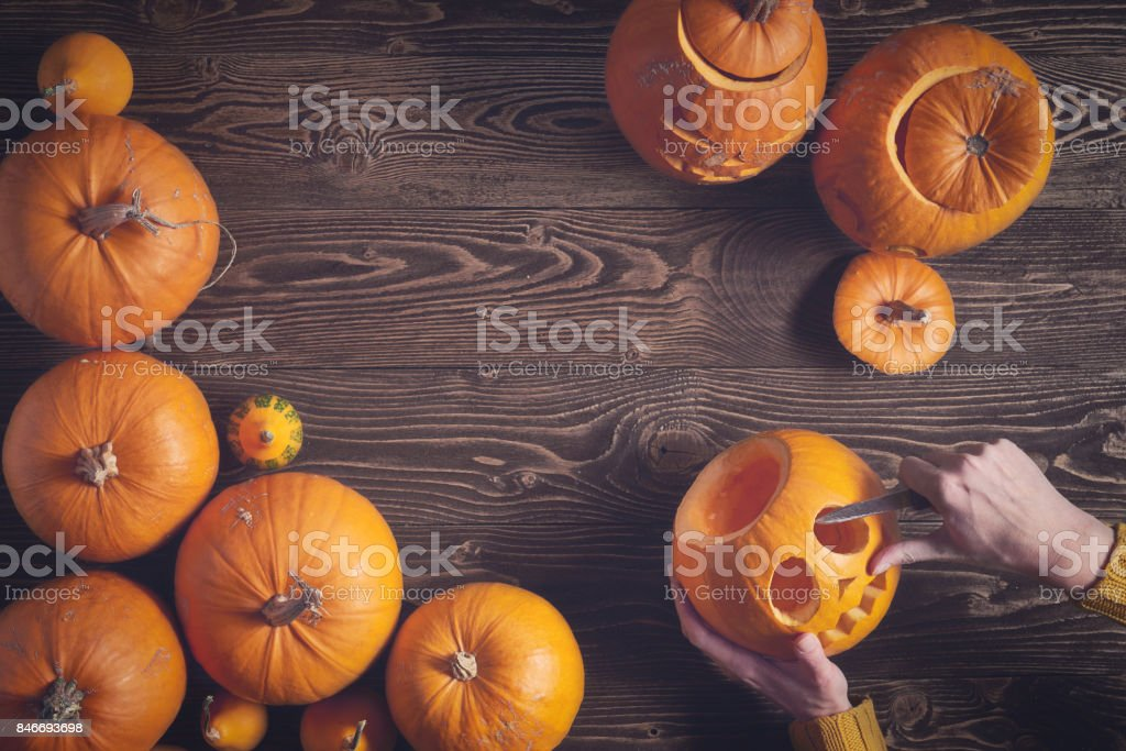 Ripe yellow pumpkins over wooden background stock photo