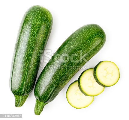 Ripe zucchini and sliced slices on a white background. The form of the top.