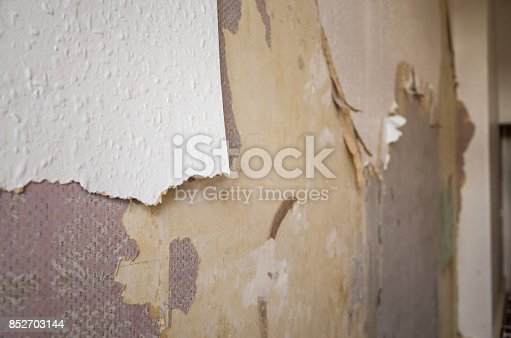 Ripped And Torn Wallpaper During Renovation Stock Photo & More Pictures of Abandoned