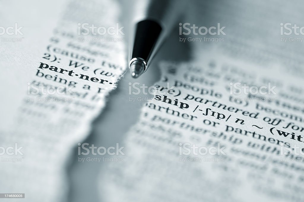 Ripped dictionary page series: partnership stock photo