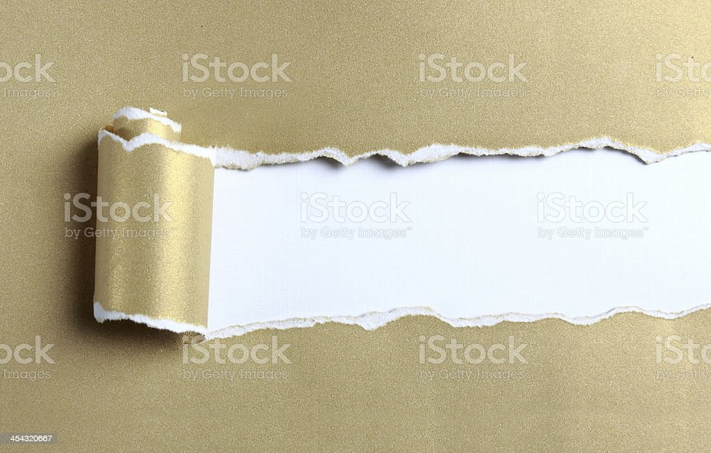 Ripped gold paper stock photo