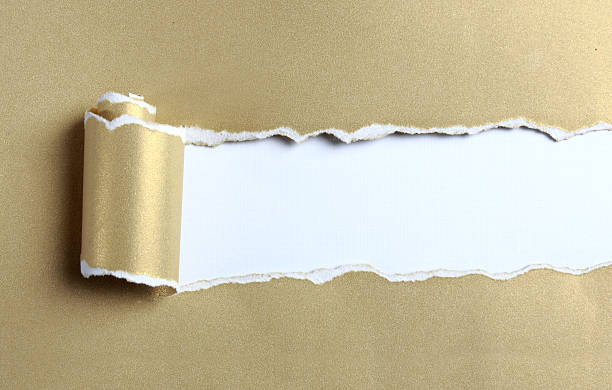 ripped gold paper - wrapping paper stock photos and pictures