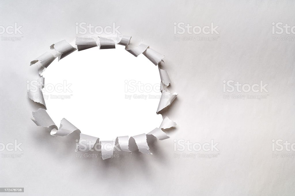 Ripped hole in a blank paper royalty-free stock photo