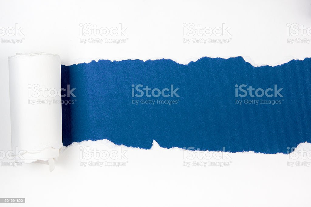 Ripped paper, space for copy, blue inside white stock photo