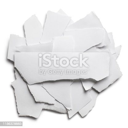 Ripped pieces of paper with a blank piece on top for a short text, isolated on white background