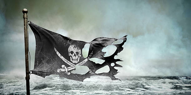 ripped torn flag - pirates stock photos and pictures