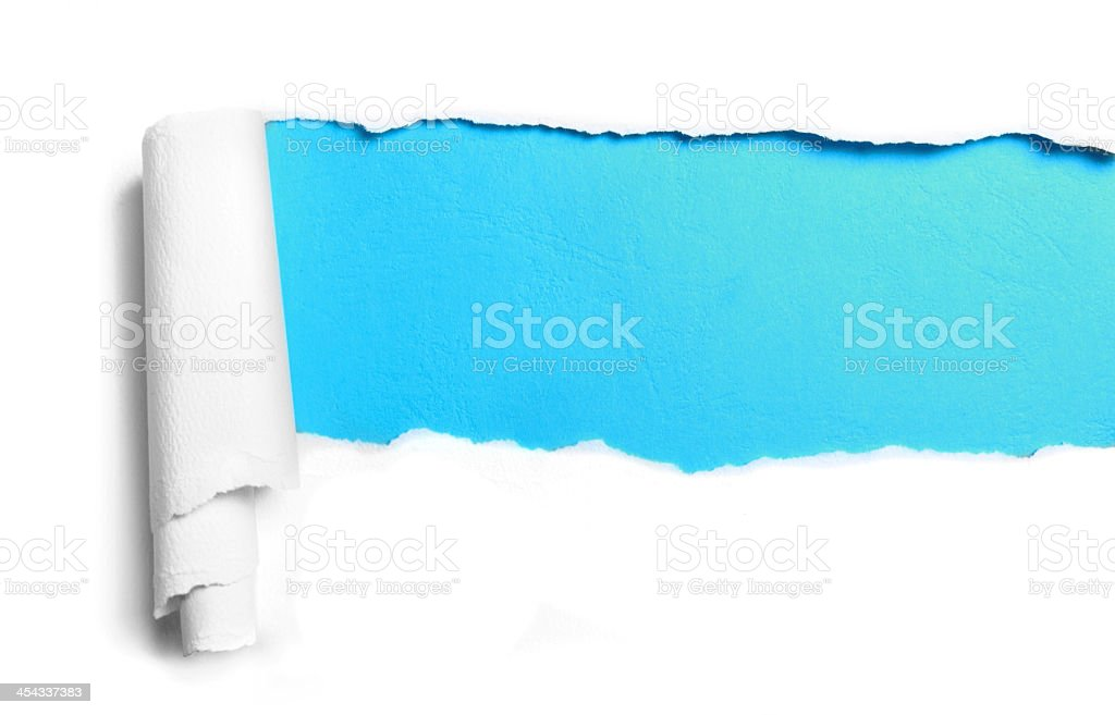 Ripped white table paper with blue showing through stock photo