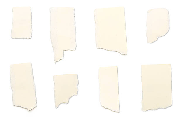 ripped yellow pieces of paper, isolated on white stock photo