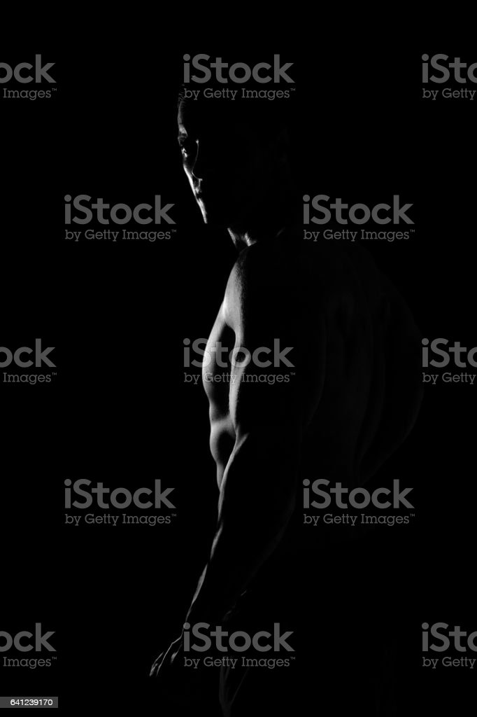 Ripped young man stock photo