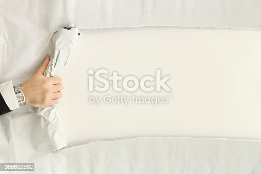 170011440 istock photo ripping a paper sheet 988652562