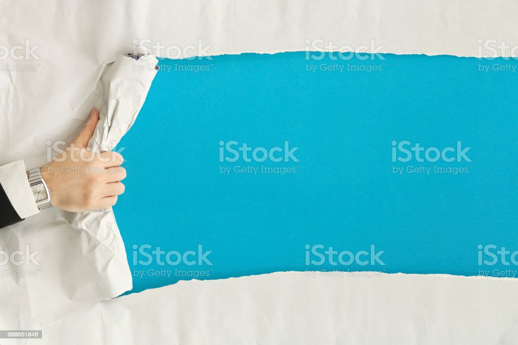 ripping the paper stock photo