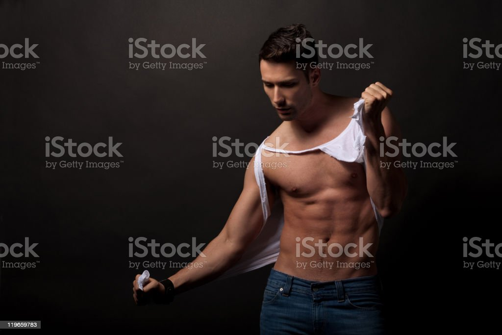 Ripping the shirt stock photo