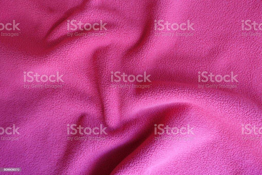 Rippled bright ruby red polar fleece fabric stock photo