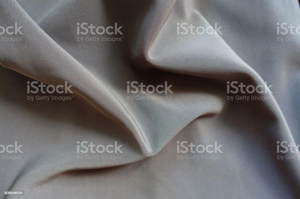 Rippled dark grey viscose, cotton and polyester fabric stock photo