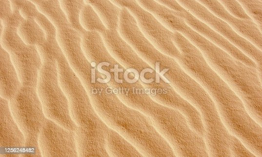 Golden colored pattern of sand