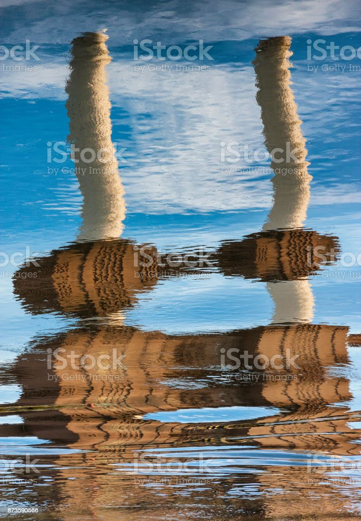 Rippled Reflections Of Battersea Power Station stock photo
