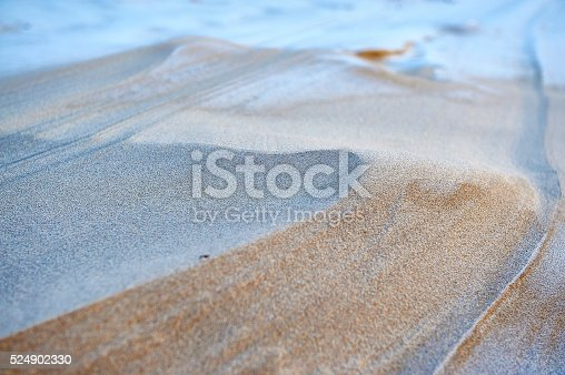 Sand ripples shaped by the wind. Natural pattern in sand on a beach. Background image