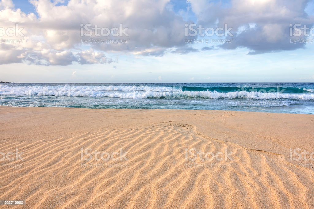 Ripples in sand on tropical beach stock photo