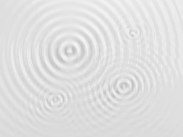 Ripples on a white background. Ripples on a white liquid surface, milk or cream texture. 3D illustration. Abstract background. rippled stock pictures, royalty-free photos & images