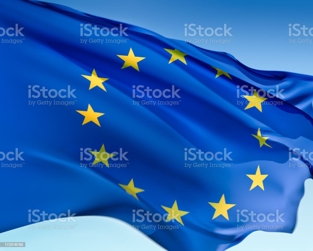 Rippling European Union flag against pale blue background royalty-free stock photo