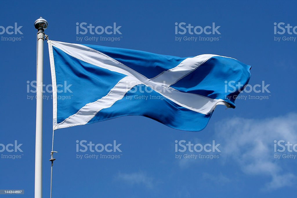 A rippling Scottish flag under blue sky stock photo