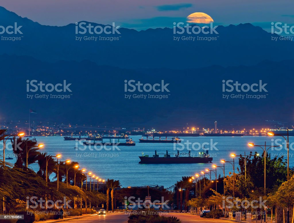 Rise of the supermoon above Jordanian mountains stock photo