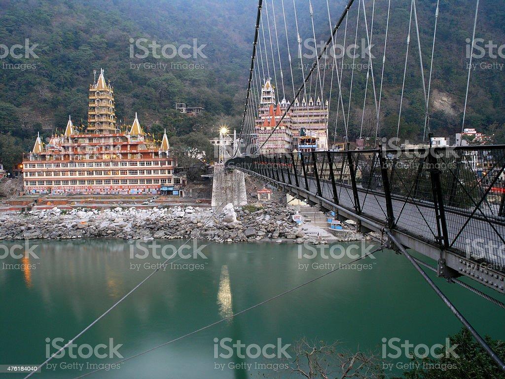 Rishikesh Lakshman Jhula bridge, Ganga river, Tryambakeshvar Temple. stock photo