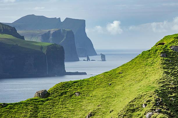 risin and kellingin from kalsoy, faroe islands - faeröer stockfoto's en -beelden
