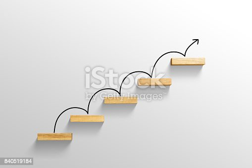 istock rising arrow on staircase, increasing business 840519184