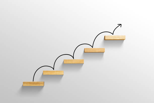 rising arrow on staircase, increasing business stock photo