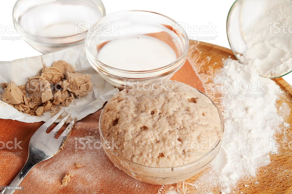 Rising baker's yeast in a bowl. stock photo