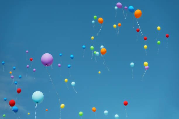 Rising balloons stock photo