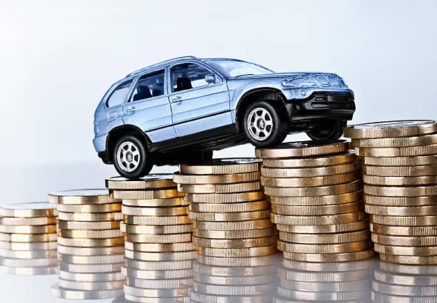 Rising car costs stock photo