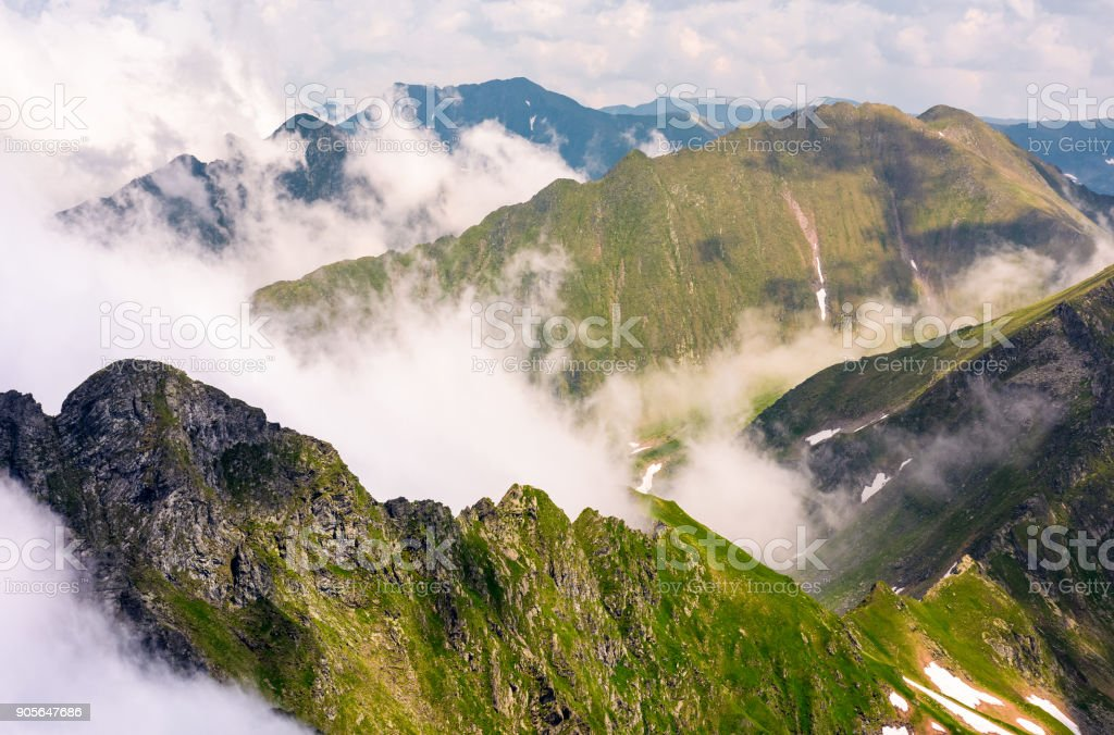 rising clouds over the Fagaras mountains stock photo