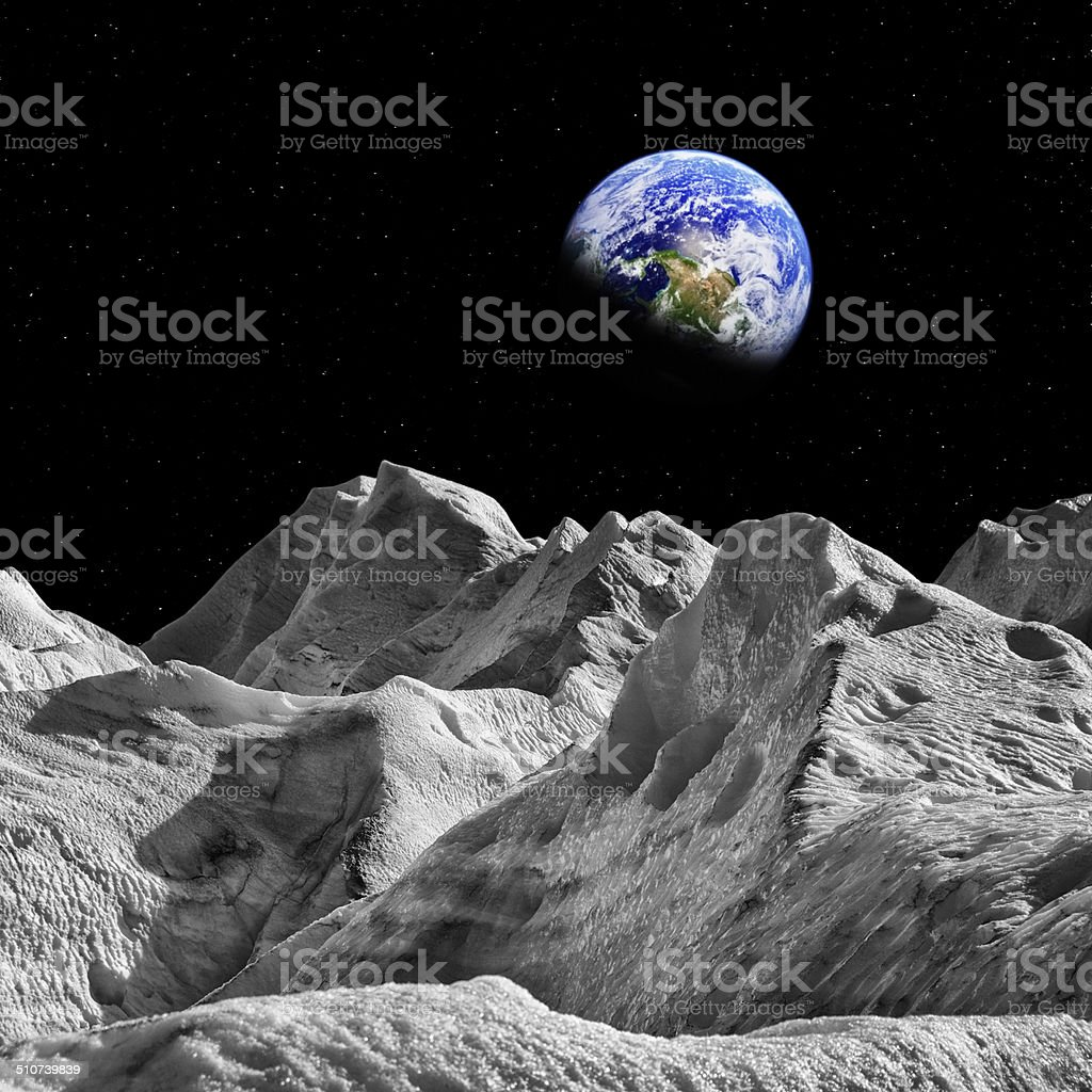 Rising Earth over a Meteor Surface stock photo