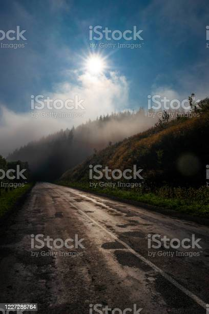 Photo of Rising fog over the road in the early mornin