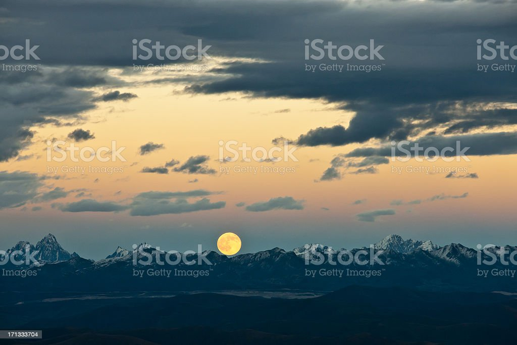 rising moon over mountains royalty-free stock photo
