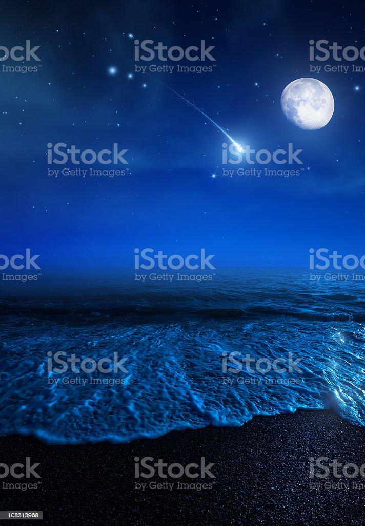 Rising moon over sea stock photo