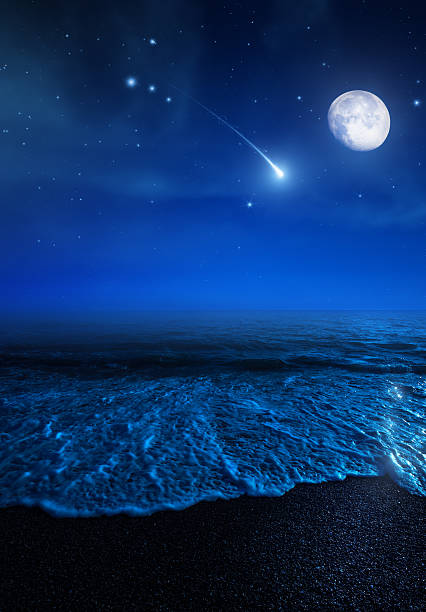 rising moon over sea - shooting stars stock photos and pictures