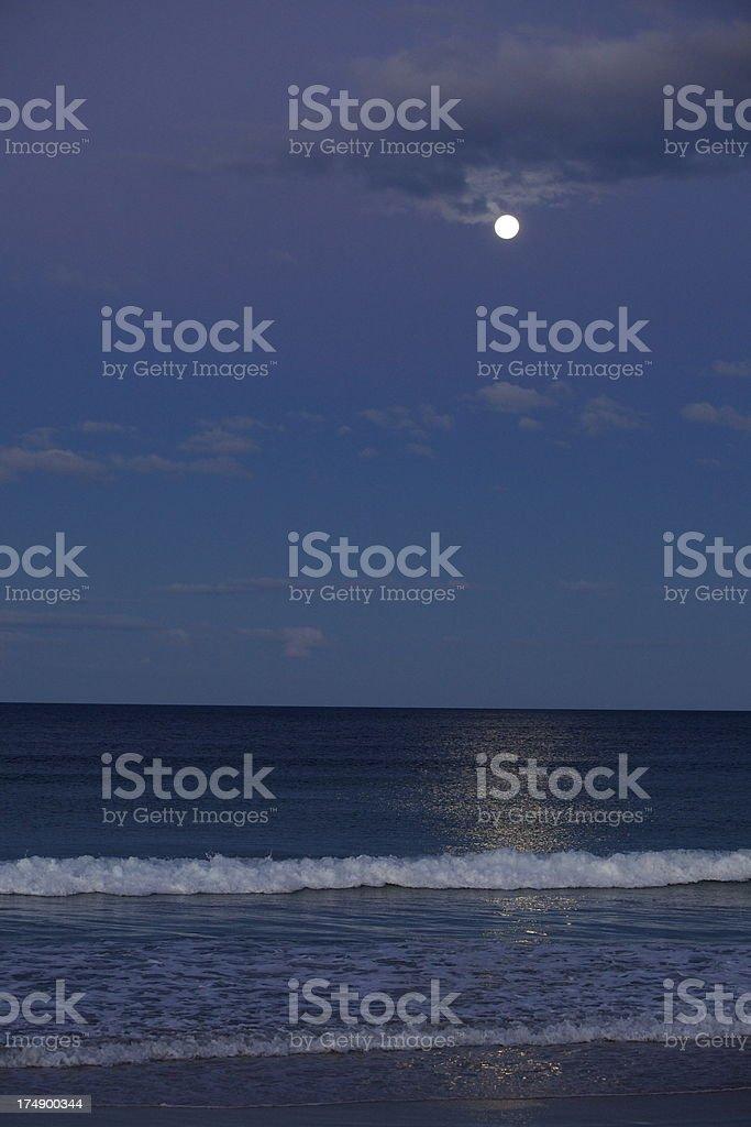 Rising moon over sea royalty-free stock photo
