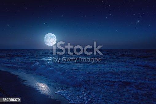 istock Rising moon over sea 539259379