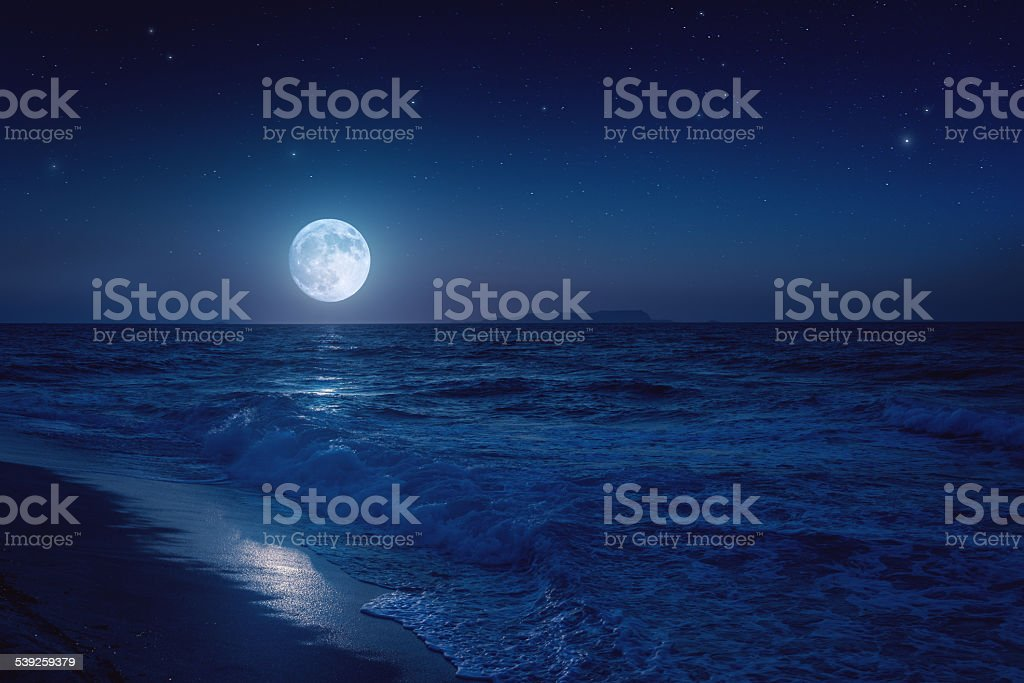 Rising moon over sea stock photo