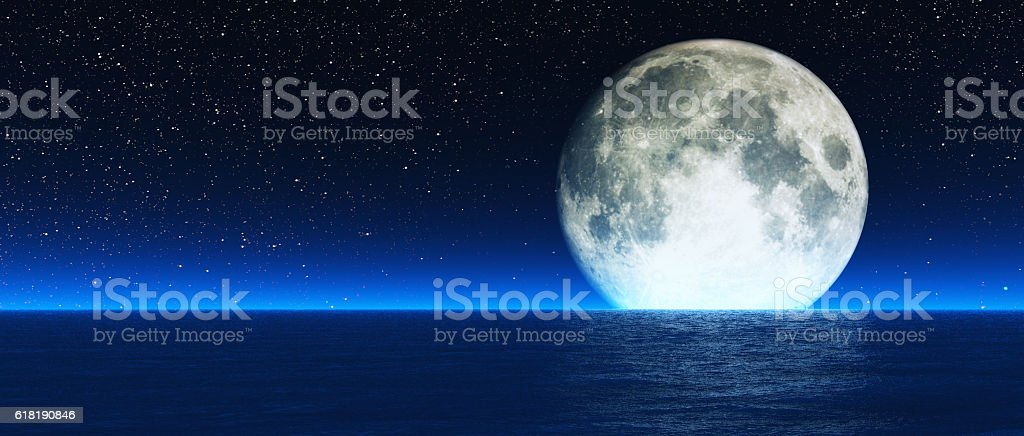 Rising moon over sea. stock photo
