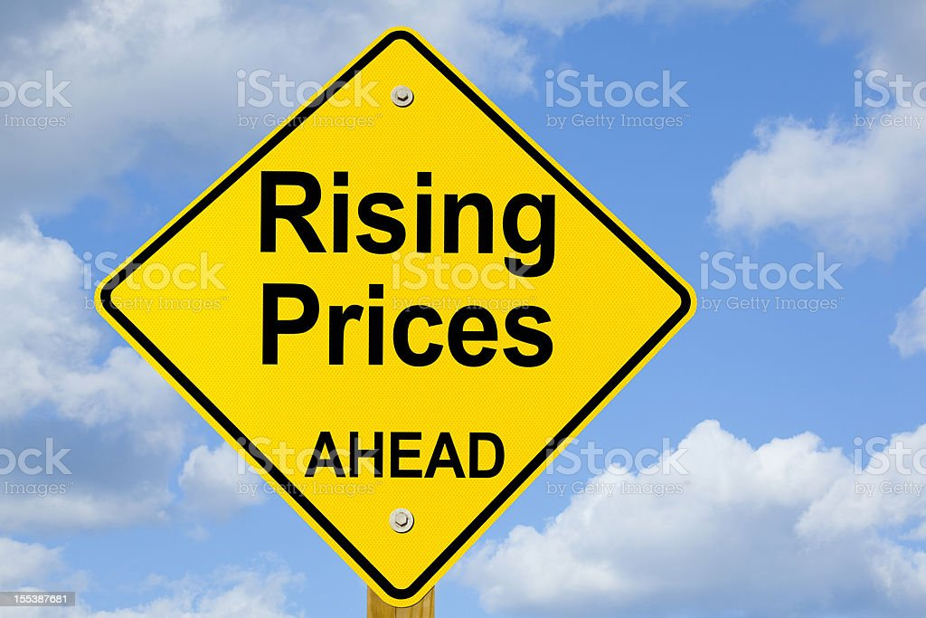 Rising Prices Ahead Road Sign stock photo